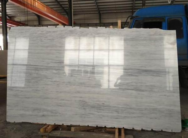 Marble slabs are produced by cutting large blocks into 16mm or 30mm thickness and then polished. Our ordinary size is 2.4m*1.4m some materials can reach 3.1m*1.8m